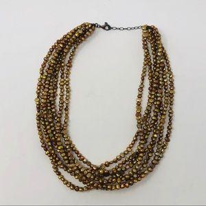 EUC Multi strands of Gold & Bronze beaded necklace